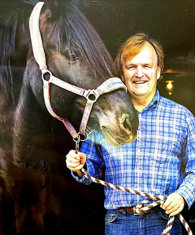 Dr. Keith Murch standing with a horse